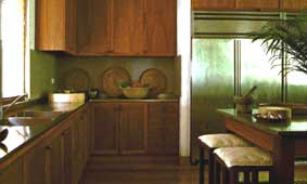 Consistent mix of wood and steel in the ample kitchen cabinets