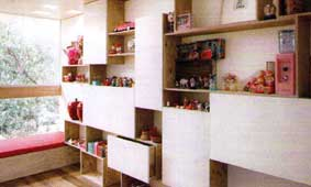 Clever wall cabinets act as a display cum storage in the children's room