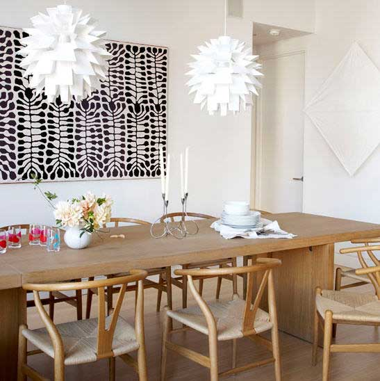 Colorful wishbone chairs dining area