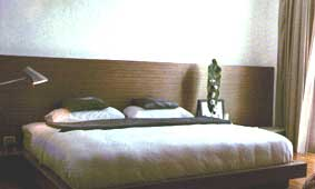 Partial Wall Cladding Matches the Bedroom Furnishing