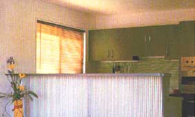 Striped Spashback Blends Well with Venetian Blinds and Contrasts with Verticle Stripes on Bar